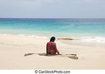 woman alone on beach