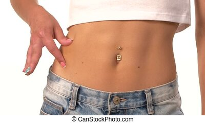 Woman analyzing cellulite on her belly, pinching, on white