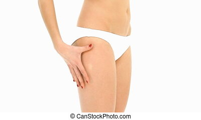 woman analyzing cellulite on her buttocks
