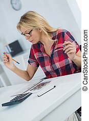 woman analyzing home finances