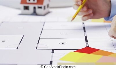 woman and architect discussing blueprint of house