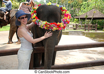 Woman and baby elephant