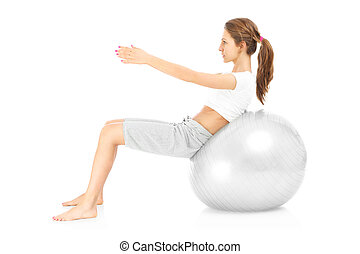 Woman and ball sit ups