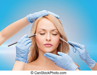 woman and beautician hands with pencil and scalpel