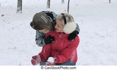 Woman and boy hugging on the street in winter