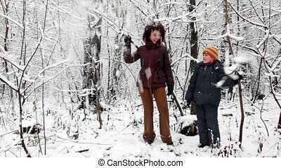 woman and boy in snow forest