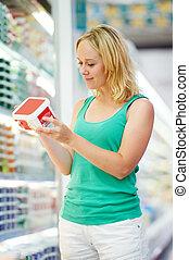woman and boy making shopping