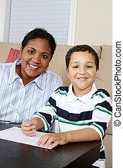 Woman and Boy Writing