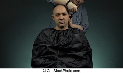 Woman and caucasian bald man - Footage of shaving man's head...