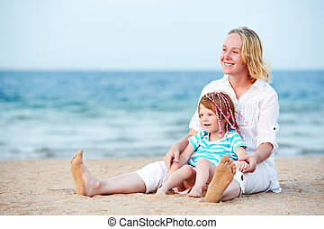Woman and child at sea beach