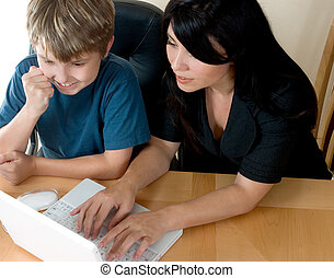 Woman and child on computer
