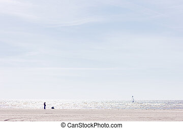 Woman and child on the beach of the Baltic