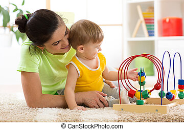 woman and child play in nursery