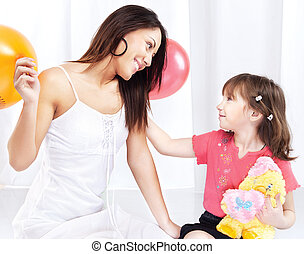 Woman and child playing - Brunette woman and child playing