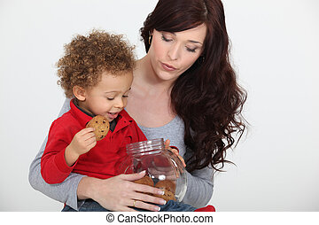 Woman and child with a cookie jar