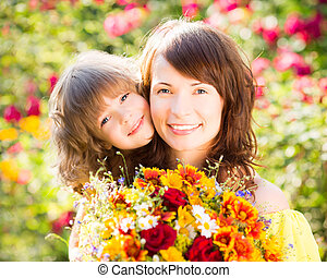 Mother`s day - Woman and child with bouquet of flowers...