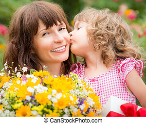 Mother's day - Woman and child with bouquet of flowers ...