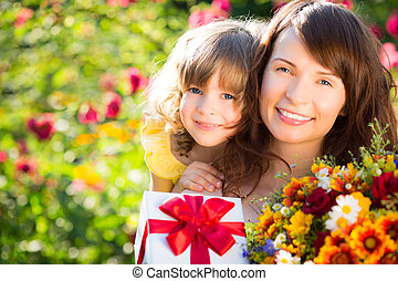 Mother`s day - Woman and child with bouquet of flowers ...