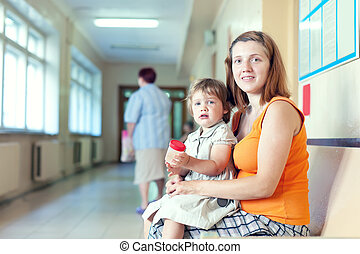 woman and child  with urinalysis sample