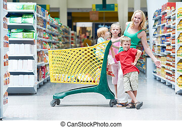 woman and children making shopping