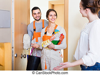 Woman and cleaning service workers