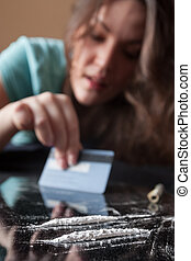 Woman and cocaine - Young woman and two line of cocaine