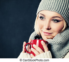 Woman and Coffee or Tea Cup. Woman in Cotton Hat and Woolen Scarf