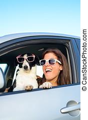 Woman and dog fun in car