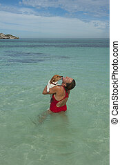 Woman and dog swimming - A woman and her dog are having fun ...