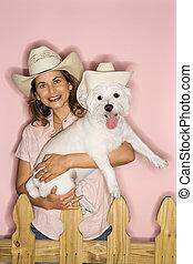 Woman and dog wearing cowboy hats.