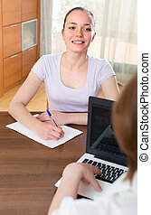 Woman and employee with laptop
