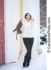 woman and falcon in winter