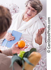 Woman and friend's visit - Older sick woman in hospital and...