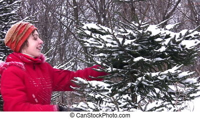 woman and fur-tree in snow - Woman and fur-tree in snow