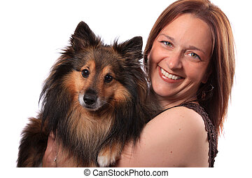 Woman and furry dog - Attractive woman in her early forties...