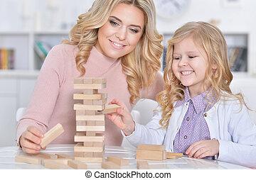 woman and girl playing