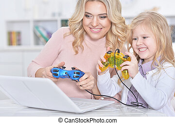 woman and girl playing video game
