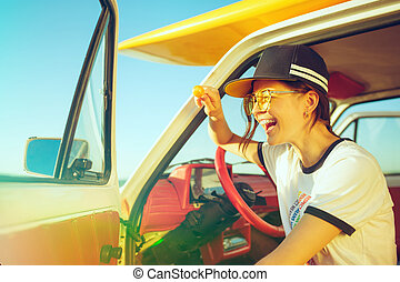 Woman and happy trip by car