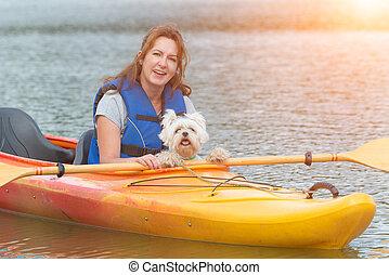 Woman and her dog on a kayak