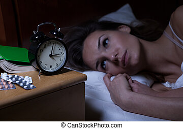 Woman and her drugs for depression at night