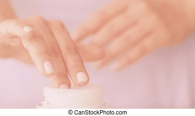 Woman and her morning skincare routine, female hand applying moisturizing cream or body lotion for healthy skin, organic cosmetic product and luxury beauty brand, stock footage
