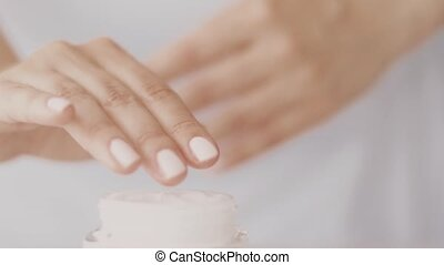 Woman and her skincare routine, female hand applying moisturizing cream or body lotion for healthy skin, organic cosmetic product and luxury beauty brand, stock footage