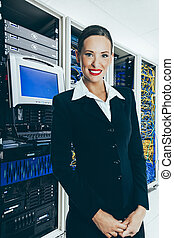 Woman and IT Communication Cabinets - The mainframe and...