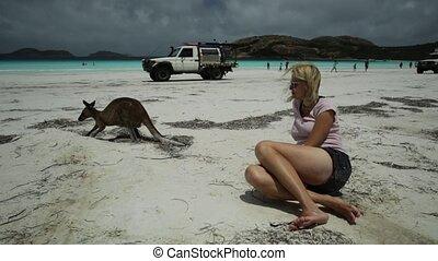 Woman and kangaroo Australia - Happy woman lying on pristine...