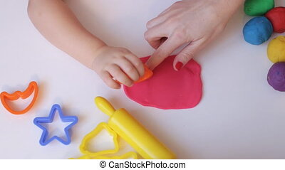 Woman and kid hands