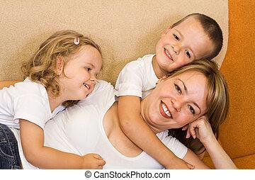 Woman and kids on the sofa
