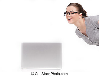 Woman and laptop. Cheerful young women in glasses looking at the computer monitor and smiling while isolated on white