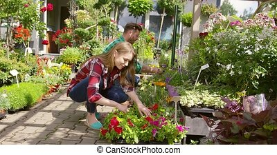 Woman and making taking care of plants