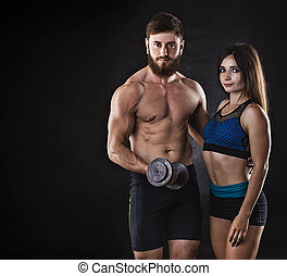 woman and man athletes on a black background.