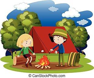 Woman and man camping at night